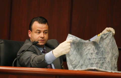 CCBI Deputy Director Andy Parker explains the identification of shoe-prints on a pillow cover during Jason Young's retrial on February 16, 2012, in Raleigh, North Carolina. Young is accused of murdering his wife Michelle on November 3, 2006, in their Wake County home.. (Pool photo Shawn Rocco/Raleigh News & Observer/MCT)