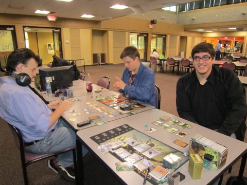 Pictured left to right: Mason Meyer, Steve Wolbert and Jimmy Barnes pit their play skills and deck building creativity against each other in a game of Magic: The Gathering. Photo by Logan Pierce