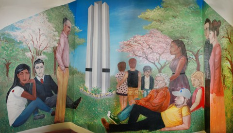 Dr. Bret wood and Professor Suzanne Thomas are featured alongside RSC students in the stairway mural.