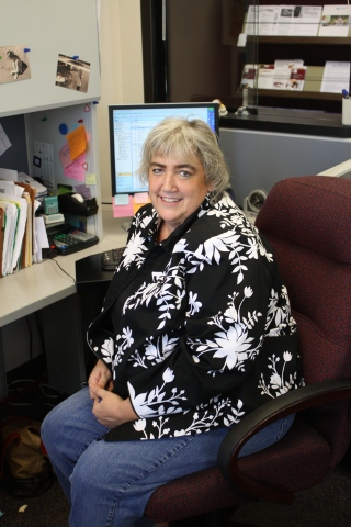 Tammy Martin keeps payroll on track with a smile.