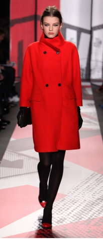 Model Shows off a wool coat during fashion week.