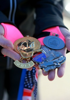 Kari Barczak shows medals from previous marathons and other runs in Redford Township, Michigan, in December 2011, as she works to keep her goal of remaining fit in the coming year. (Regina H. Boone/Detroit Free Press/MCT)