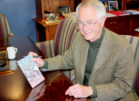 "Dr. Terry Britton shows off his book of poetry, ""Along the Washita."" Photo by Josi Weaver"