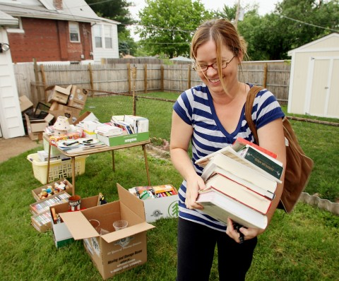 Emily Farquar of south St. Louis County walks off with an armload of books that she bought Friday at a garage sale. Source of pic is MCTcampus.com