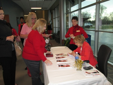 """Dr. Mary Ann Bauman signed her book """"Fight Fatigue"""" for attendees of the conference after her presentation. Photo by Amber Stafford."""