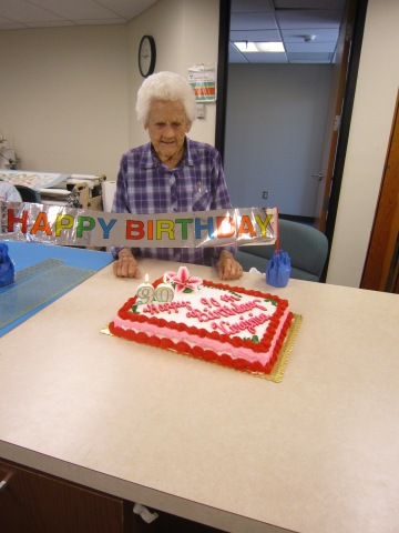 Mrs. Virginia Cline is the center of attention as her quilting class fetes her at her 90th birthday celebration.