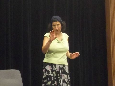 Judith Black channels Rosie the Riveter during her story of the great American heroine. Photo by Marisa Caban