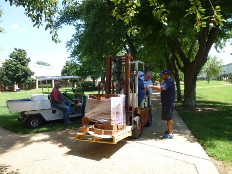 From left, Gary Hancock, general contractor, Don Reaves, maintenance employee, and Jacob Kuhn, maintenance employee, finish construction on the campus mall.