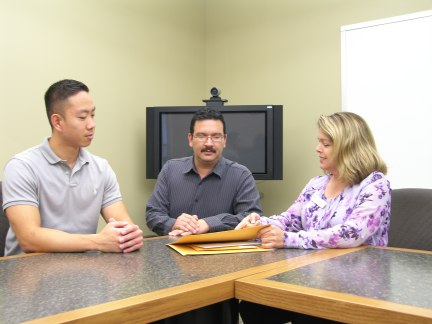 Photo: Connie Myrick (right) conducts mock interview with Sam Seonkyo (left) and Fernando Rubio (middle).   Photo by Marisa Caban