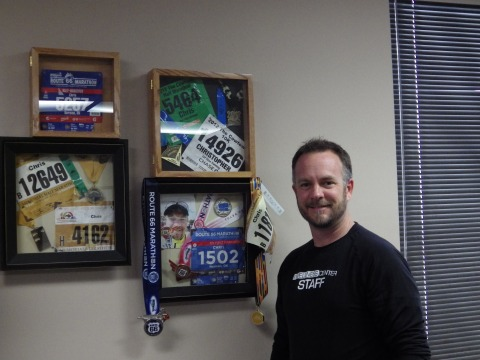 """Chris Leland, director of health and wellness activities, looks forward to adding another medal to his wall of awards, after he runs the full memorial marathon in April"""