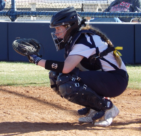 Catcher Erin Elmore gives pitching instructions during the game against the Cisco Wranglers on Feb. 22, at the RSC softball field.