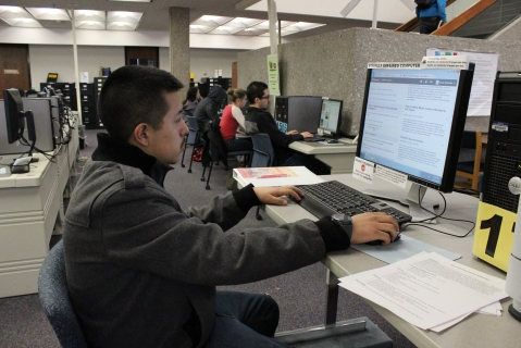 Jesus Saavedra does homework on his student D2L account Feb. 9 in the RSC library. Canvas could replace D2L as the college's learning management system; the decision will be made at the end of the semester.   Photo by Carina Snow