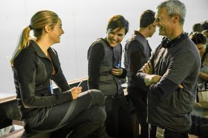 "Shailene Woodley (left), author Veronica Roth and director Neil Burger talk on the set of ""Divergent."" (Jaap Buitendijk/MCT)"