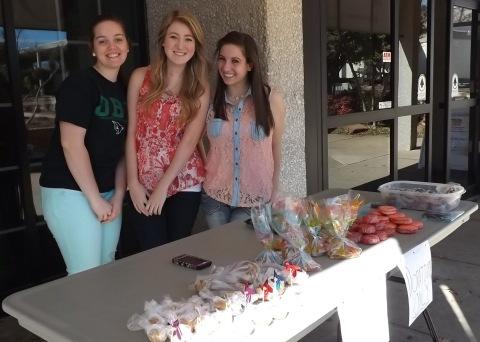 From Left, Katie VanBuskirk, Amanda Jones, Rebeckah Hadick and Kirsten Isbill (not featured) exchanged baked goods for donations for the BCM spring break retreat.