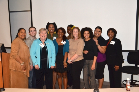 Attendees from the 2013 Women's Leadership Conference take a break fro a picture with former Lieutenant Gov. Jari Askins at RSC.