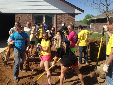 Student Senators along with faculty members from Student Activities plant a tree at a Habitat for Humanity house on April 25 in the Hope Crossing neighborhood in northwest Oklahoma City.