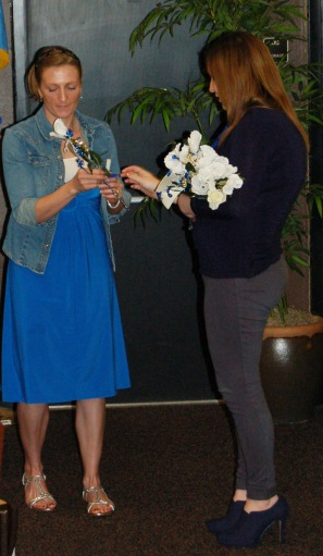 PTK inductees received a white rose from Allona Cearly, PTK vice president of leadership.