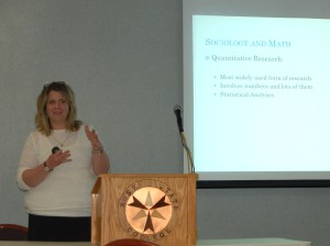 Professor of Sociology Tara Hall presents her math and sociology presentation at the Math Drives Careers workshop. (Photo by Marisa Caban)